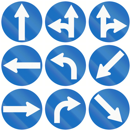 left handed: Collection of arrow signs used as traffic signs in Austria. Stock Photo