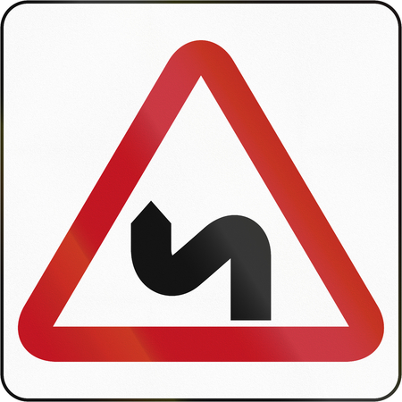 right handed: Bruneian sign warning about a double curve first to left.