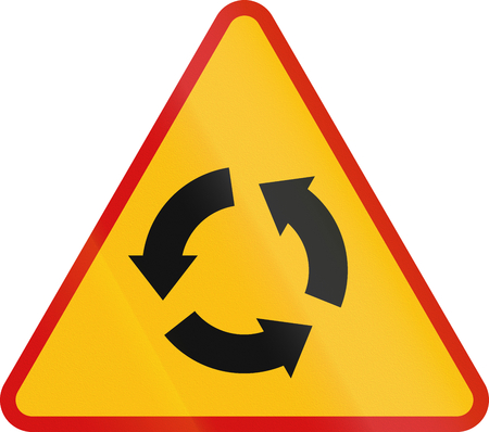 counterclockwise: Polish traffic warning sign: Intersection with traffic circle. Stock Photo