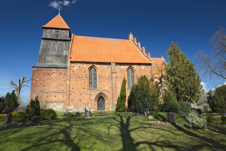 wide angle lens: Village church in Reinberg, Mecklenburg-Vorpommern, Germany, shot with wide angle lens and polarization filter.