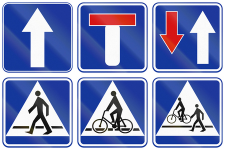 one lane road sign: Collection of informational road signs in Poland, including dead end and bike and foot path.