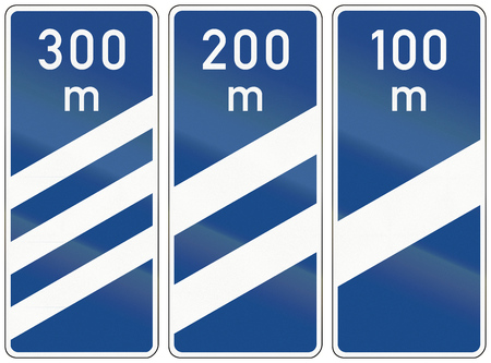 medium group of object: Different highway exit countdown markers in Germany.