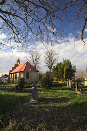 wide angle lens: Chapel and graveyard in Stahlbrode, Mecklenburg-Vorpommern, Germany, shot with wide angle lens. Stock Photo