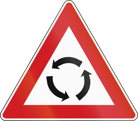 counterclockwise: Czech traffic warning sign: Intersection with traffic circle.