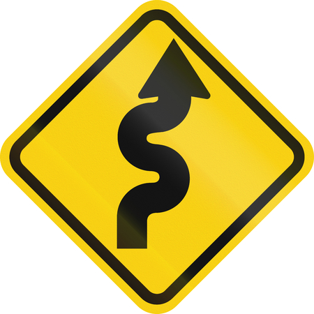 right handed: Colombian road warning sign: Winding road, right version