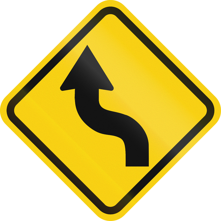 left handed: Colombian road warning sign: Reverse curve