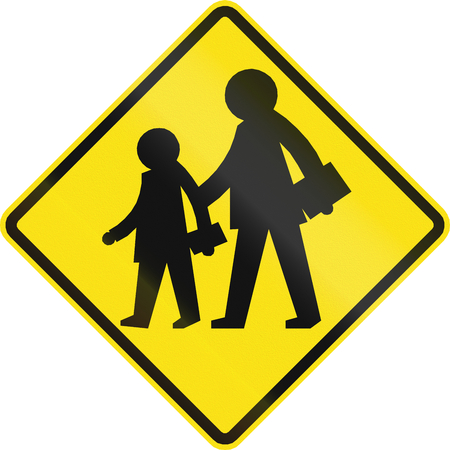 slowly: Warning road sign in Chile: School zone Stock Photo