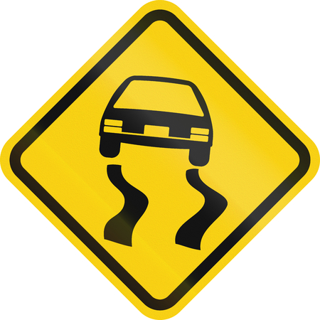 skidmarks: Colombian road warning sign: Slippery when wet Stock Photo