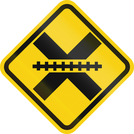 railroad crossing: Warning road sign in Colombia: Railroad crossing without gates or barriers ahead.