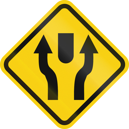 conquering adversity: Colombian road warning sign: Central Reserve With One Way Traffic