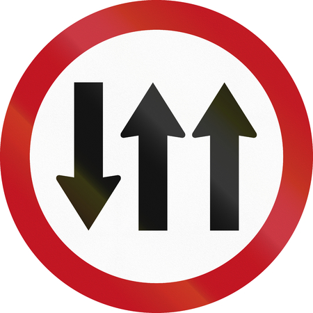 opposing: Regulatory road sign in Colombia: Opposing traffic with three lanes