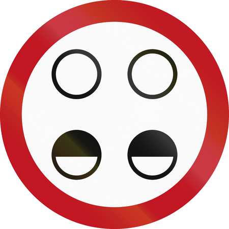requiring: Regulatory road sign in Colombia requiring you to turn your headlights on high.