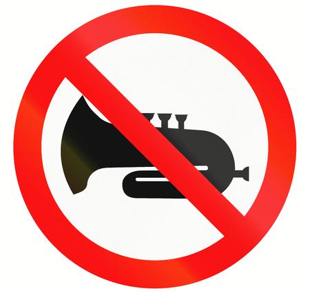 honking: An Indonesian regulatory sign - no honking.