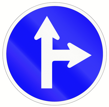 forked road: Indonesian traffic sign: Go straight or right