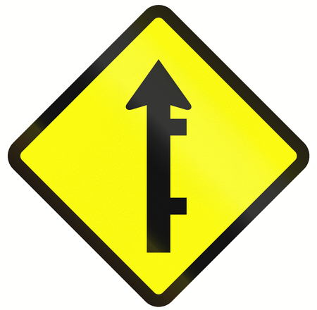 routing: Indonesian road warning sign: Offset roads intersection ahead Stock Photo