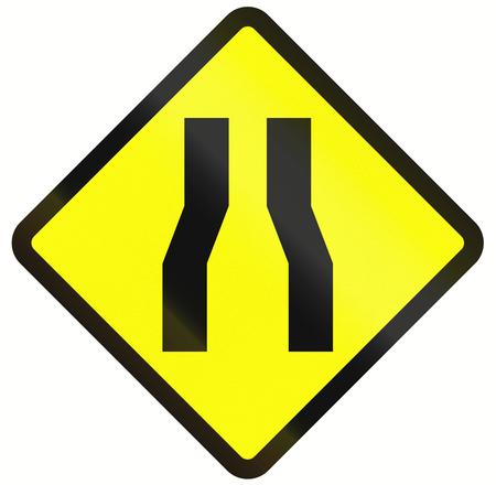 Indonesian road warning sign: One lane roadnarrow road ahead