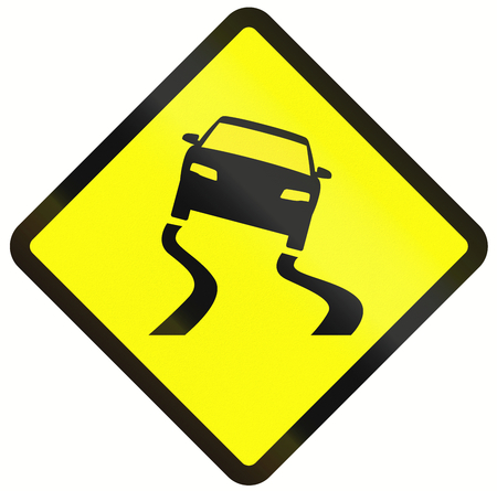 skidding: Indonesian road warning sign: Slippery when wet