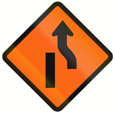 one lane roadsign: Indonesian temporary road warning sign: Diversion to the right ends Stock Photo