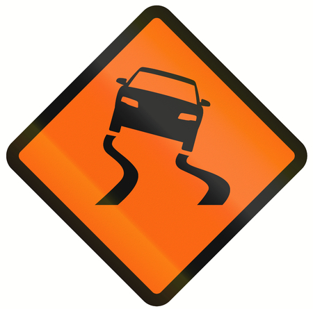 temporary: Indonesian temporary road warning sign: Slippery when wet