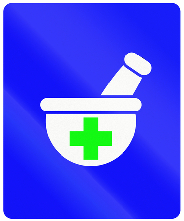 informational: An Indonesian informational road sign - Pharmacy.