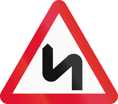 red handed: Hong Kong sign warning about a double curve first to left.