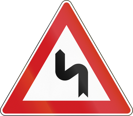left handed: Czech sign warning about a double curve first to left. Stock Photo