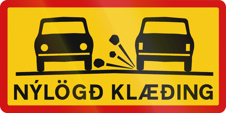 road surface: Supplementary road sign with the words in Icelandic: Newly-laid road surface Stock Photo