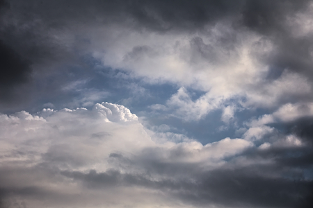sullen: High contrast cumulus cloudscape with blue sky.