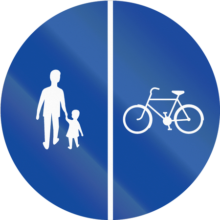 right handed: Greek traffic sign on a shared-use path with separate lanes, right lane for bicycles and left lane for pedestrians. Stock Photo