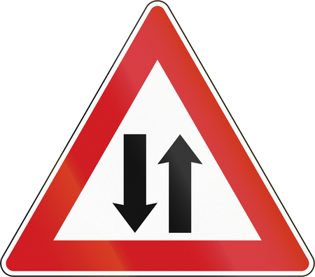 opposing: Czech sign warning about opposing traffic on a two-way road. Stock Photo
