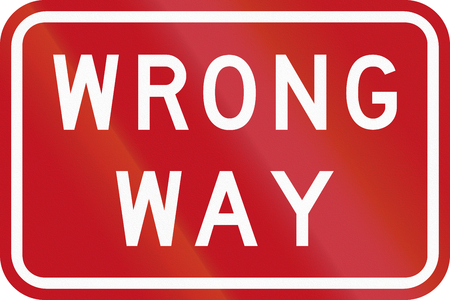 wrong way sign: An Australian traffic sign on freeway: Wrong Way