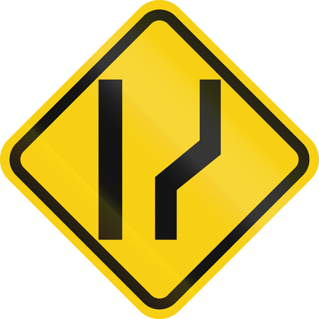 one lane road sign: Colombian road warning sign: Road widens on the right Stock Photo