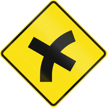 right handed: Australian road warning sign - 4 way intersection in curve ahead