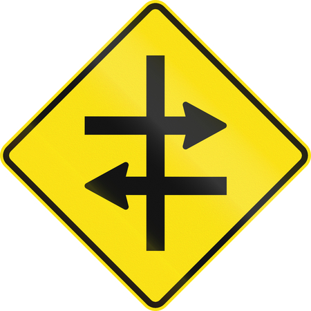 right handed: An Australian warning traffic sign - Intersection at dual carriageway Stock Photo