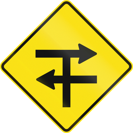 handed: An Australian warning traffic sign - T-junction at dual carriageway Stock Photo
