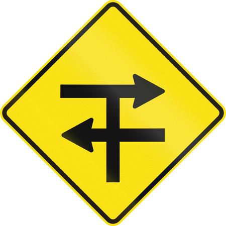 carriageway: An Australian warning traffic sign - T-junction at dual carriageway Stock Photo