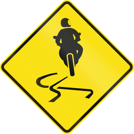 skidmarks: Australian road warning sign - Slippery when wet Stock Photo