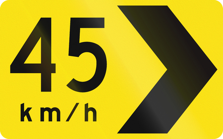 right handed: An Australian warning traffic sign - Chevron in curve with advisory speed Stock Photo