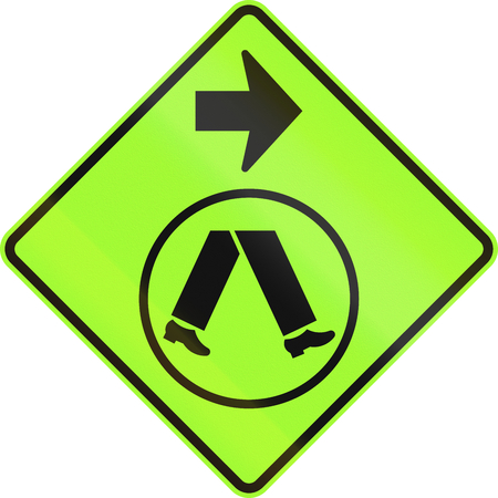 side of the road: An Australian warning traffic sign - Pedestrian Crossing Ahead on Side Road, turn right