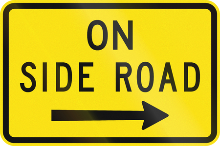 side of the road: An Australian warning traffic sign - On side road Stock Photo