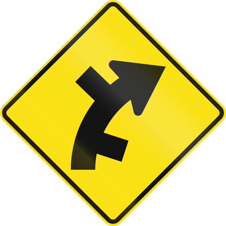 right handed: Australian road warning sign - Offset roads intersection in curve ahead