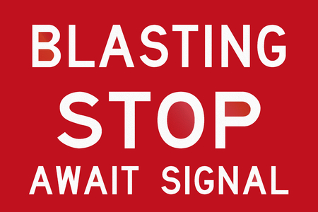 blasting: An Australian temporary road sign - Blasting, stop and await signal Stock Photo