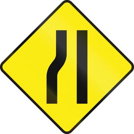 one lane roadsign: Irish road warning sign: Road narrows on the left. Stock Photo
