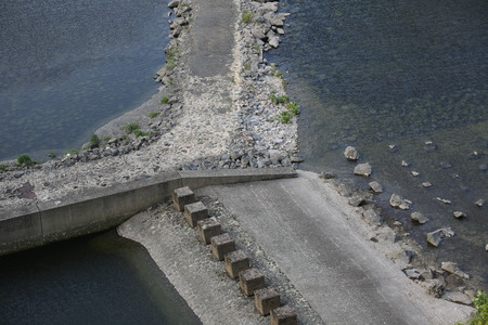 image created 21st century: Rock dams with road and water on all sides.