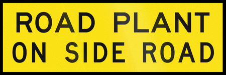 side of the road: An Australian temporary road sign - Road plant on side road