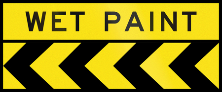 wet: Australian chevron alignment pointing to the left with the words: Wet paint Stock Photo