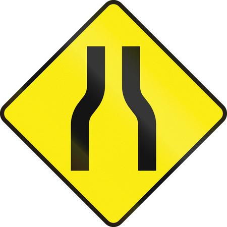 Irish road warning sign: One lane roadnarrow road ahead Stock Photo