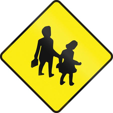 silueta niño: Advertencia señal de tráfico en Irlanda - zona de la escuela