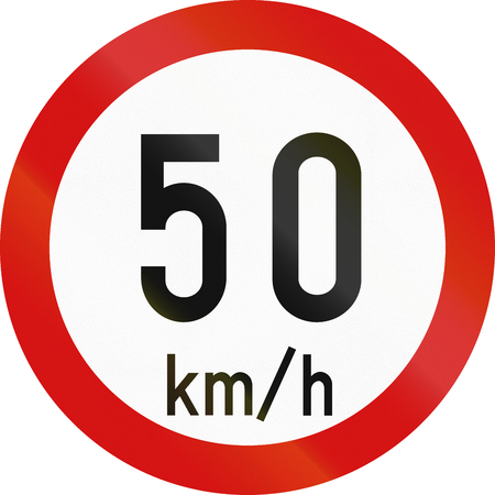 restricting: Irish traffic sign restricting speed to 50 kilometers per hour. Stock Photo