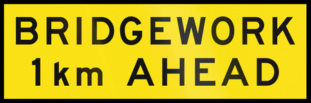 km: An Australian temporary road sign - Bridgework 1 km ahead Stock Photo